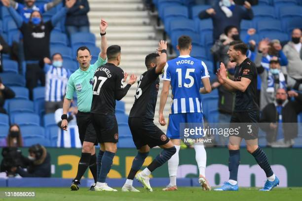 Joao Cancelo of Manchester City reacts as he is shown a red card by Match Referee, Stuart Attwell during the Premier League match between Brighton &...