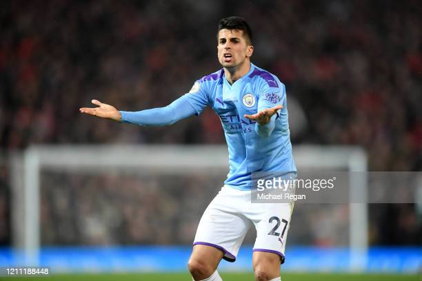 Joao Cancelo of Manchester City reacts during the Premier League match between Manchester United and Manchester City at Old Trafford on March 08,...