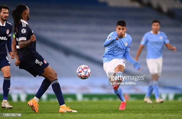 Joao Cancelo of Manchester City scores his sides third goal during the UEFA Champions League Group C stage match between Manchester City and...