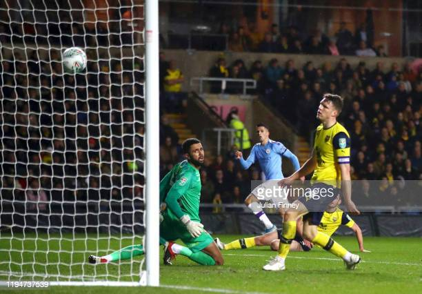 Joao Cancelo of Manchester City scores his team's first goal during the Carabao Cup Quarter Final match between Oxford United and Manchester City at...