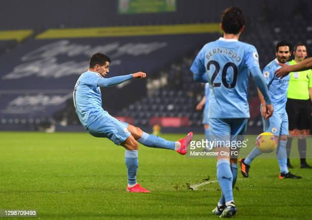 Joao Cancelo of Manchester City scores their team's second goal during the Premier League match between West Bromwich Albion and Manchester City at...
