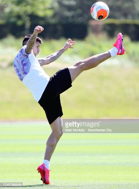 Joao Cancelo of Manchester City stretches for the ball during the training session at Manchester City Football Academy on June 01 2020 in Manchester...