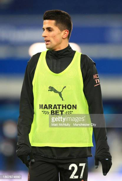 Joao Cancelo of Manchester City warms up during the Premier League match between Everton and Manchester City at Goodison Park on February 17, 2021 in...