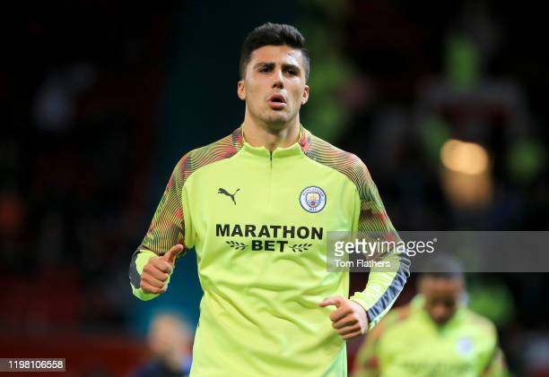 Joao Cancelo of Manchester City warms up prior to the Carabao Cup Semi Final match between Manchester United and Manchester City at Old Trafford on...