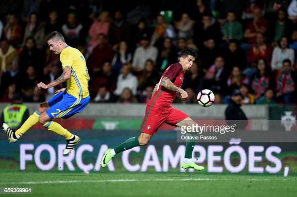 Joao Cancelo of Portugal competes for the ball with Mikael Lustig of Sweden during the International friendly match between Portugal and Sweden at...