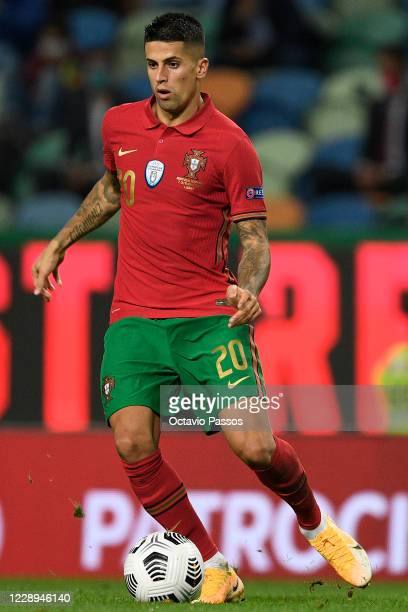 Joao Cancelo of Portugal controls the ball during the international friendly match between Portugal and Spain at Estadio Jose Alvalade on October 7,...