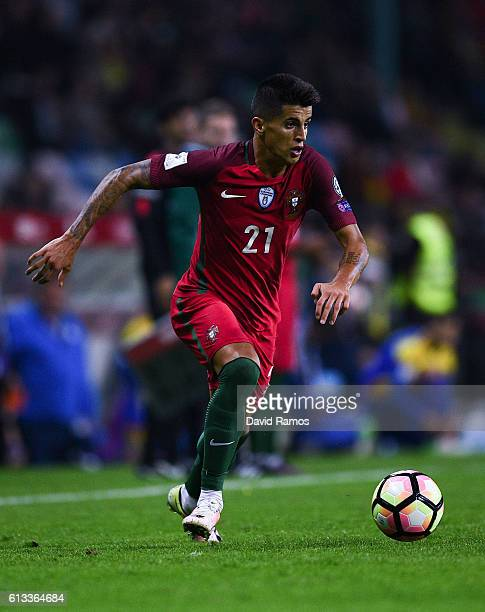 Joao Cancelo of Portugal runs with the ball during the FIFA 2018 World Cup Qualifier between Portugal and Andorra at Estadio Municipal de Aveiro on...