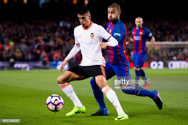 Joao Cancelo of Valencia CF protects the ball from Rafinha of FC Barcelona during the La Liga match between FC Barcelona and Valencia CF at Camp Nou...