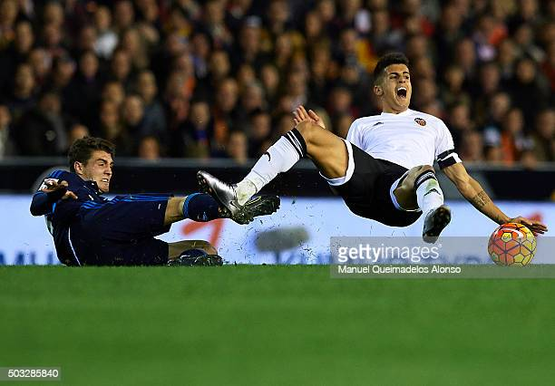 Joao Cancelo of Valencia is tackled by Mateo Kovacic of Real Madrid during the La Liga match between Valencia CF and Real Madrid CF at Estadi de...