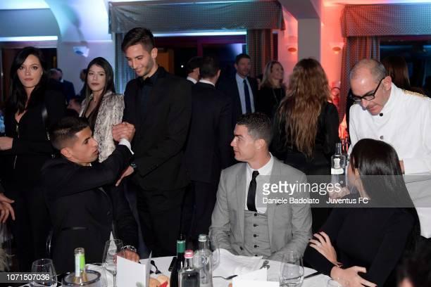 Joao Cancelo Rodrigo Bentancur and Cristiano Ronaldo during the Juventus XMas Dinner on December 10 2018 in Turin Italy