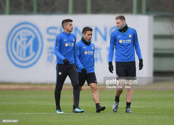 Joao Cancelo Yuto Nagatomo and Milan Skriniar of FC Internazionale chat during the FC Internazionale training session at Suning Training Center at...