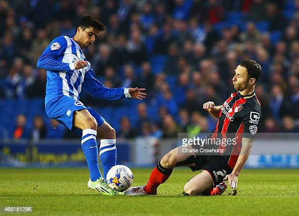 Joao Carlos Teixeira of Brighton and Hove Albion is tackled by Marc Pugh of Bournemouth during the Sky Bet Championship match between Brighton Hove...
