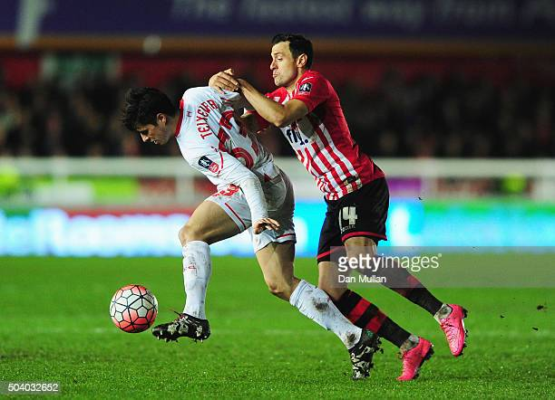 Joao Carlos Teixeira of Liverpool and Alex Nicholls of Exeter City battle for the ball during the Emirates FA Cup third round match between Exeter...