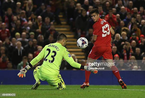 Joao Carlos Teixeira of Liverpool backheels past Adam Federici of Bournemouth during the Capital One Cup Fourth Round match between Liverpool and AFC...