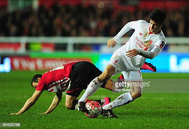Joao Carlos Teixeira of Liverpool evades Alex Nicholls of Exeter City during the Emirates FA Cup third round match between Exeter City and Liverpool...