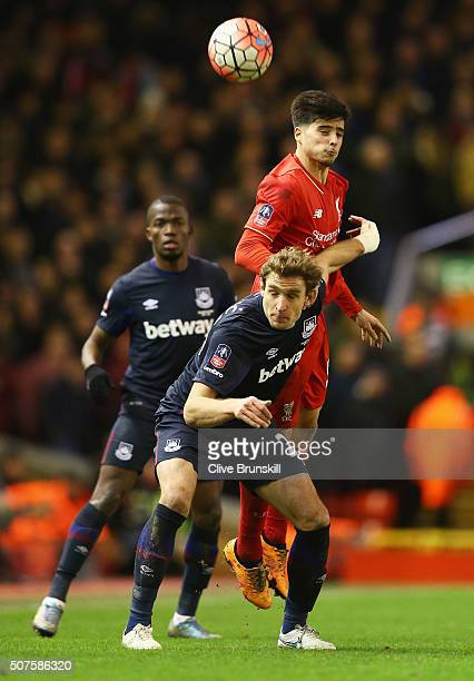 Joao Carlos Teixeira of Liverpool outjumps Nikica Jelavic of West Ham United during the Emirates FA Cup Fourth Round match between Liverpool and West...