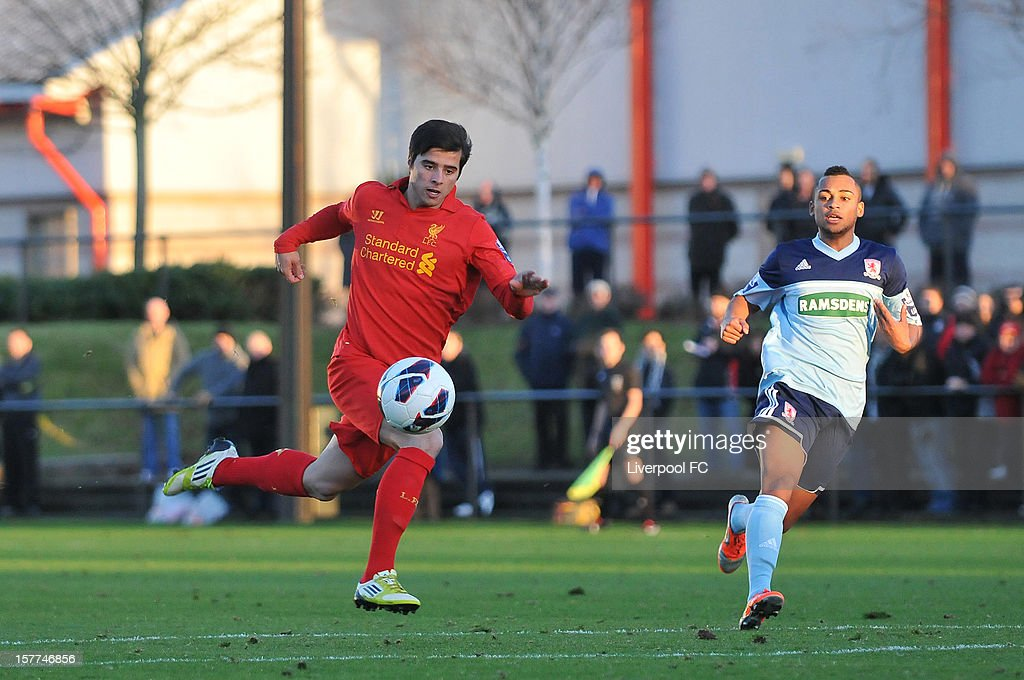Joao Carlos Teixeira of Liverpool runs with the ball during U21 Barclays Premier League match between Liverpool U21 and Middlesbrough U21 at The Academy on November 23, 2012 in Liverpool, England.