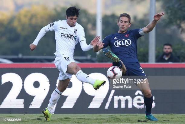 Joao Carlos Teixeira of Vitoria SC with Goncalo Silva of Belenenses SAD in action during the Liga NOS match between Belenenses SAD and Vitoria SC at...