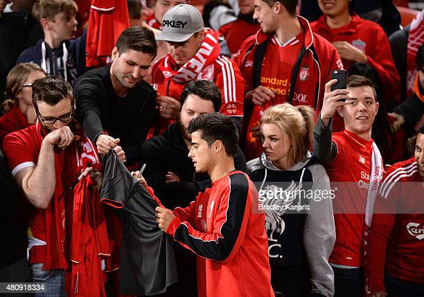 Joao Carlos Teixeira signs autographs for fans during a Liverpool FC training session at Suncorp Stadium on July 16 2015 in Brisbane Australia