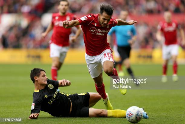 Joao Carvalho of Nottingham Forest and Christian Norgaard of Brentford during the Sky Bet Championship match between Nottingham Forest and Brentford...