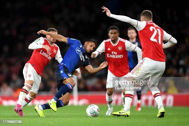 Joao Carvalho of Nottingham Forest battles for the ball with Calum Chambers Lucas Torreira and Reiss Nelson of Arsenal during the Carabao Cup Third...