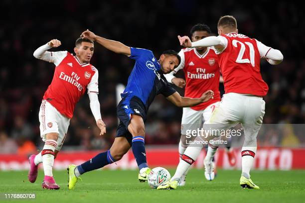 Joao Carvalho of Nottingham Forest battles for the ball with Calum Chambers, Lucas Torreira and Reiss Nelson of Arsenal during the Carabao Cup Third...