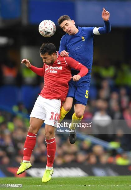 Joao Carvalho of Nottingham Forest jumps for the ball with Jorginho of Chelsea during the FA Cup Third Round match between Chelsea and Nottingham...