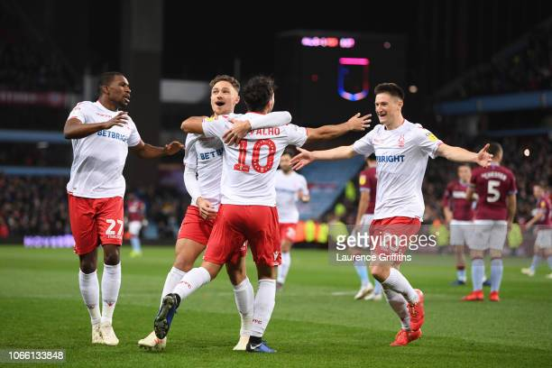 Joao Carvalho of Notts Forest is mobbed by team mates after scoring to make it 2-0 during the Sky Bet Championship match between Aston Villa and...