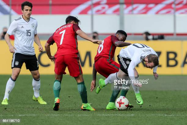 Joao Carvalho of Portugal Carlos Mane of Portugal und Maximilian Arnold battle for the ball during the International Friendly match between Germany...