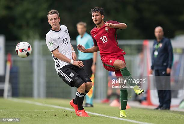 Joao Carvalho of Portugal is challenged by Max Besuschkow of Germany during the UEFA Under19 European Championship match between U19 Germany and u19...