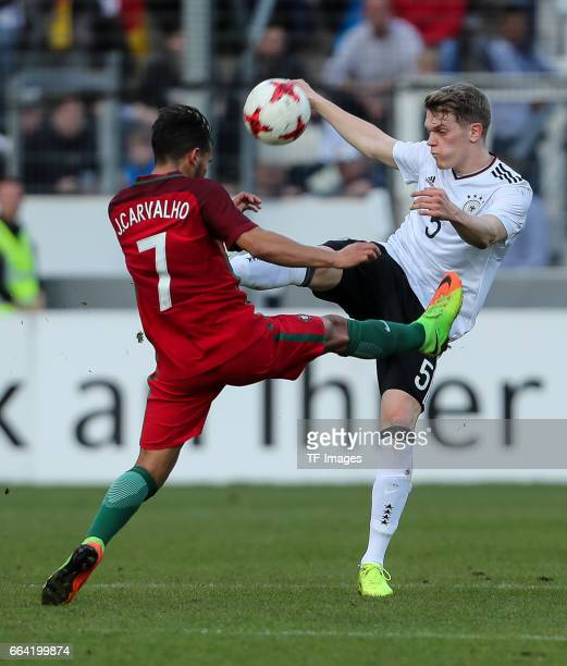 Joao Carvalho of Portugal und Matthias Ginter of Germany battle for the ball during the International Friendly match between Germany U21 and Portugal...