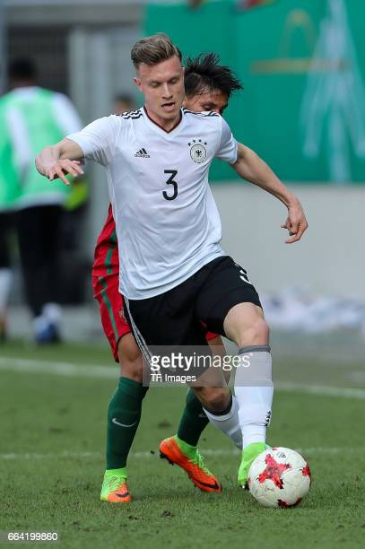 Joao Carvalho of Portugal und Yannick Gerhardt of Germany battle for the ball during the International Friendly match between Germany U21 and...
