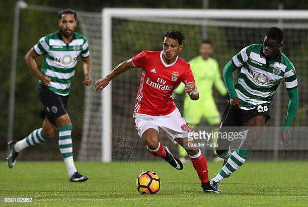 Joao Carvalho of SL Benfica B with Bubacar Djalo of Sporting CP B in action during the Segunda Liga match between SL Benfica B and Sporting CP B at...