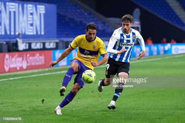 Joao Carvalho of UD Almeria controls the ball under pressure from Javier Puado of RCD Espanyol during the LaLiga SmartBank match between RCD Espanyol...