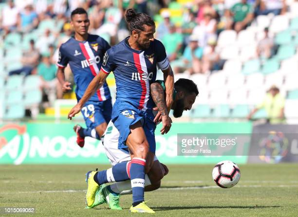 Joao Costinha of Vitoria FC with Nelson Lenho of Desportivo das Aves in action during the Liga NOS match between Vitoria FC and CD Aves at Estadio do...