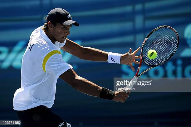 Joao de Souza of Brazil returns the ball in the Men's Singles tennis match against Ecuador's Campozano July during 2011 Pan American Games Telcel...