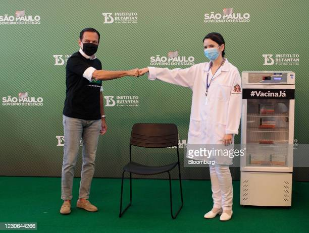 Joao Doria, governor of Sao Paulo, greets Jessica Pires de Camargo, master of public health at Santa Casa de Sao Paulo, before the first Sinovac...