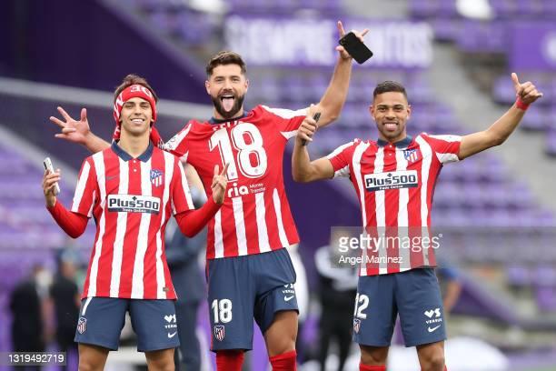 Joao Felix, Felipe and Renan Lodi of Atletico de Madrid celebrate winning the La Liga Santander title after victory in the La Liga Santander match...