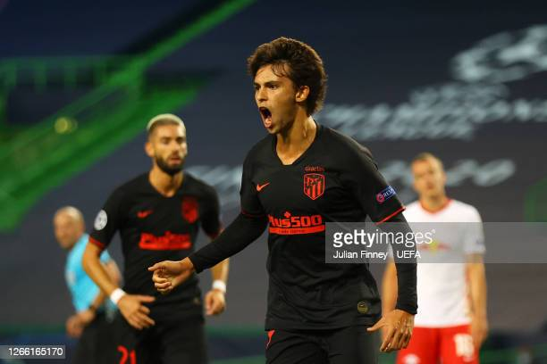Joao Felix of Atletico de Madrid celebrates after scoring his team's first goal during the UEFA Champions League Quarter Final match between RB...