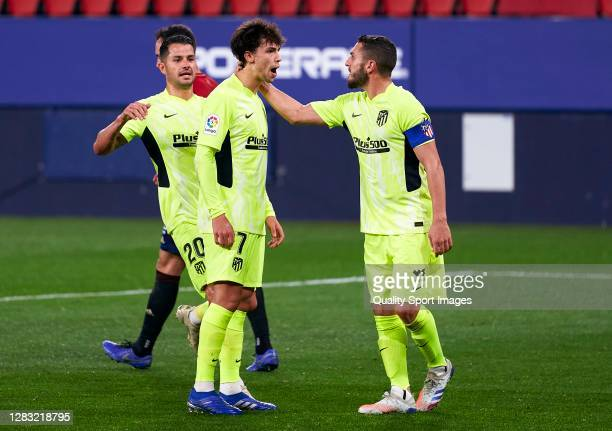 Joao Felix of Atletico de Madrid celebrates after scoring his team's first goal with his teammates Koke and Vitolo during the La Liga Santander match...