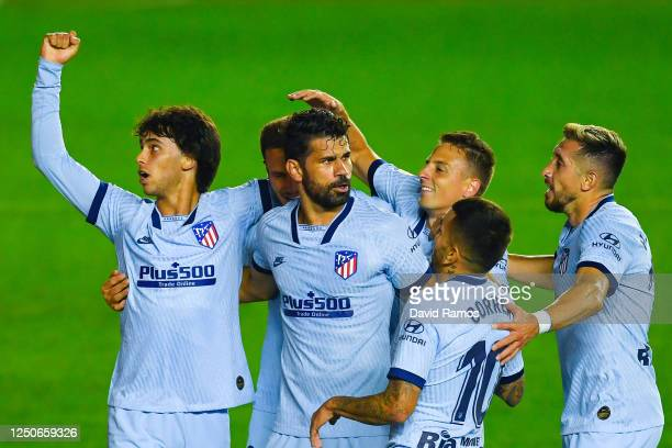Joao Felix of Atletico de Madrid celebrates with his team mates after scoring his team's first goal during the Liga match between CA Osasuna and Club...