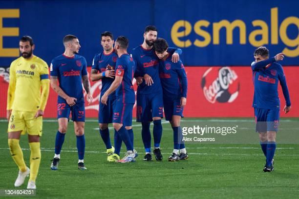 Joao Felix of Atletico de Madrid celebrates with his teammate Felipe Augusto after scoring his team's second goal during the La Liga Santander match...