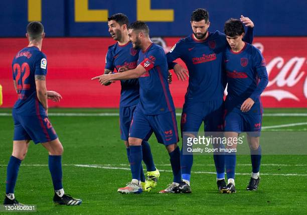 Joao Felix of Atletico de Madrid celebrates with his teammates after scoring his team's second goal during the La Liga Santander match between...