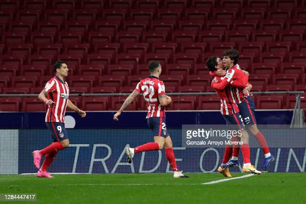 Joao Felix of Atletico de Madrid celebrates with teammate Jose Gimenez after scoring his team's first goal during the La Liga Santader match between...