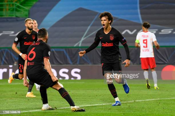 Joao Felix of Atletico de Madrid celebrates with teammate Koke after scoring his team's first goal during the UEFA Champions League Quarter Final...