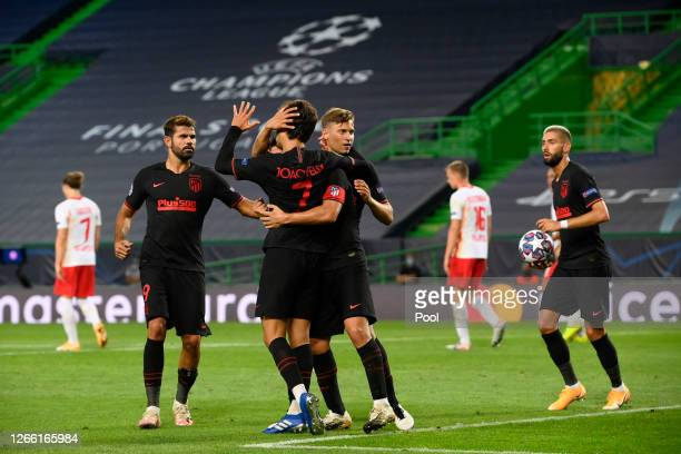 Joao Felix of Atletico de Madrid celebrates with teammates after scoring his team's first goal during the UEFA Champions League Quarter Final match...
