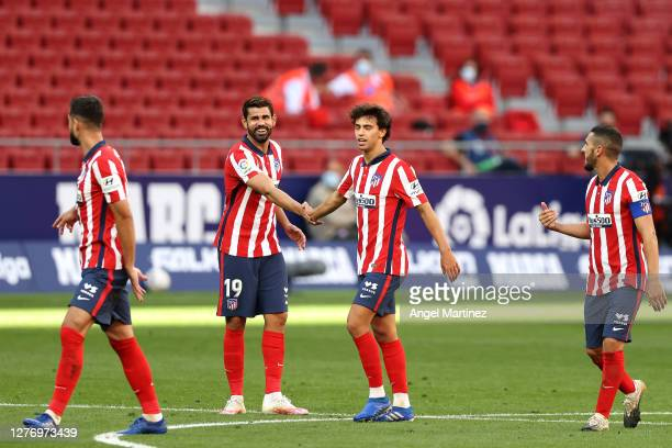 Joao Felix of Atletico de Madrid celebrates with teammates after scoring his sides third goal during the La Liga Santander match between Atletico de...