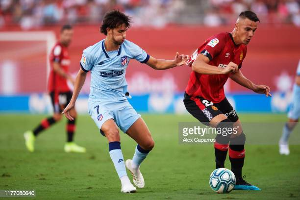 Joao Felix of Atletico de Madrid competes for the ball with Martin Valjent of RCD Mallorca during the La Liga match between RCD Mallorca and Club...