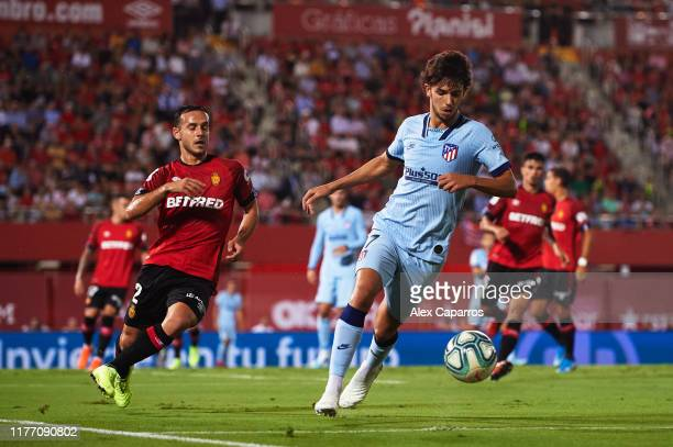 Joao Felix of Atletico de Madrid controls the ball under pressure from Joan Sastre of RCD Mallorca during the La Liga match between RCD Mallorca and...