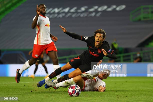 Joao Felix of Atletico de Madrid is fouled by Lukas Klostermann of RB Leipzig inside the penalty area leading to Atletico de Madrid being awarded a...